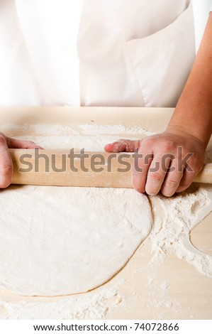woman hands knead dough - stock photo