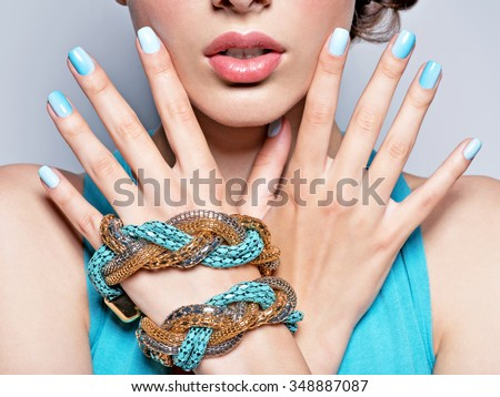 woman hands nails manicure fashion blue jewelry. Female hands with blue fingernails - stock photo
