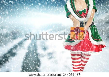 woman hands of box and green elf place  - stock photo