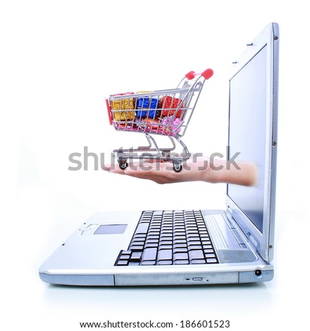 woman hands out of a laptop and holding a trolley, isolated on white background - stock photo