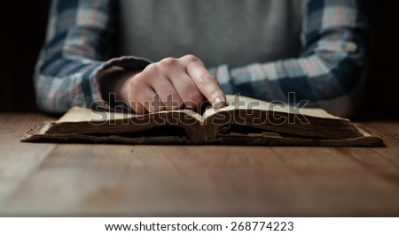 Woman hands reading the bible - stock photo