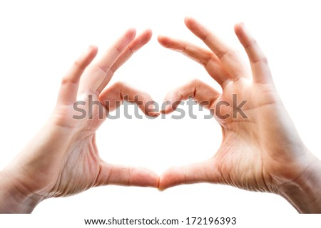 Woman hands showing heart gesture, isolated on the white background, with light coming from inside the shape - stock photo