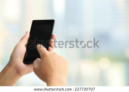 woman hands use smart phone in modern city  - stock photo