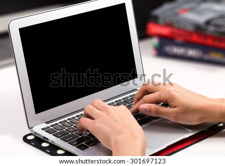 woman hands  using laptop at office desk, with black screen - stock photo
