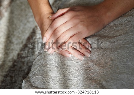 Woman hands with beautiful french manicure. - stock photo