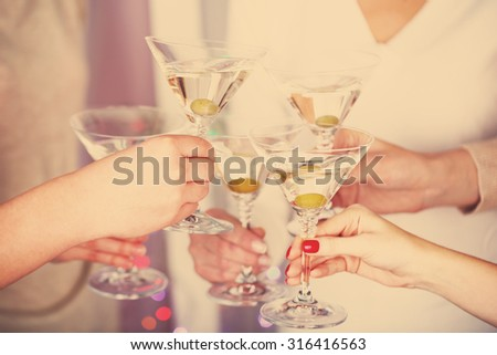 Woman hands with glasses of champagne - stock photo