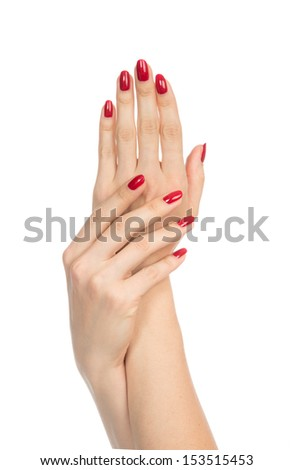 Woman hands with manicured red nails isolated on a white background. Skin and nail care concept - stock photo