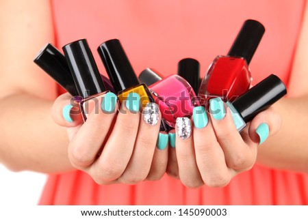 Woman hands with nail polishes, close-up - stock photo