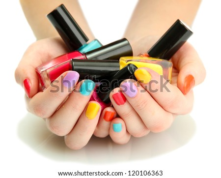 woman hands with nail polishes isolated on white - stock photo