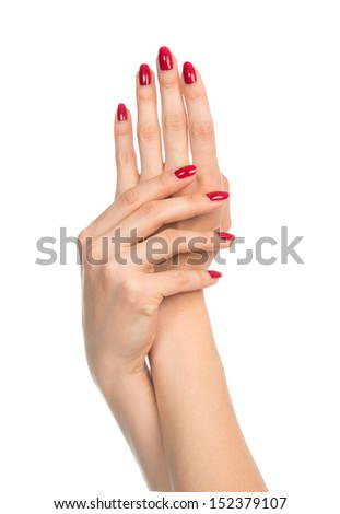 Woman hands with red manicured nails isolated on a white background - stock photo