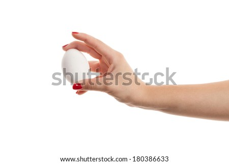 Woman hands with white egg isolated on white background - stock photo