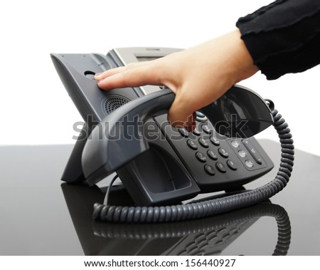 woman hanging up the phone - stock photo