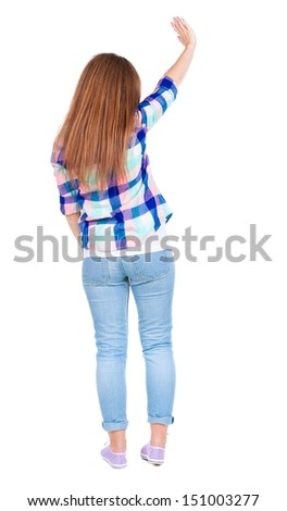 woman happily greets someone. girl waving. Rear view people collection.  backside view of person.  Isolated over white background.  - stock photo