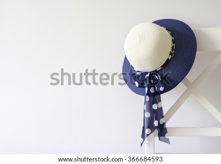 Woman hat hanging on the chair - stock photo