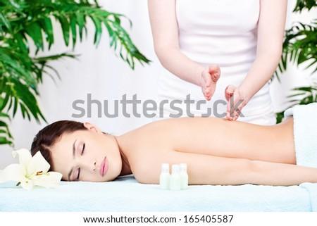 Woman having a back massage - stock photo