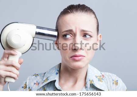 Woman having a bad hair day  - stock photo