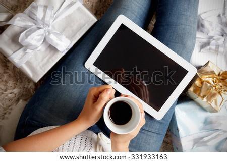Woman having a coffee at Christmas - stock photo
