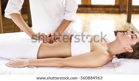 Woman having abdomen massage. - stock photo