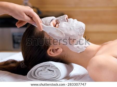 Woman having beauty treatments in the spa salon - stock photo