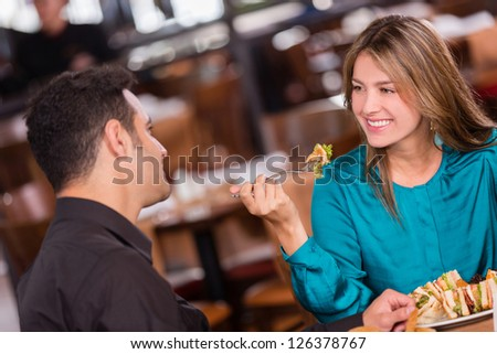 Woman having dinner with her boyfriend at a restaurant - stock photo