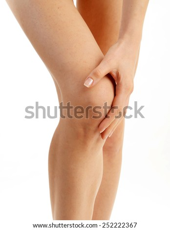 Woman having knee pain isolated  - stock photo