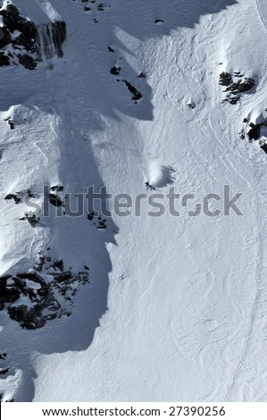 woman having made a daring jump to the top left of the image enters the steep central corridor in the womens 2009 freeride world championship finals - stock photo