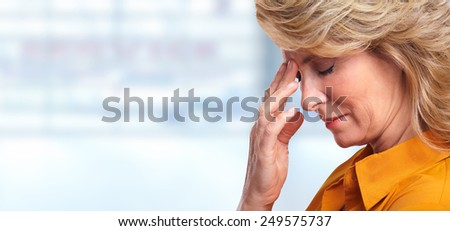 Woman having migraine headache. Stress and depression. - stock photo