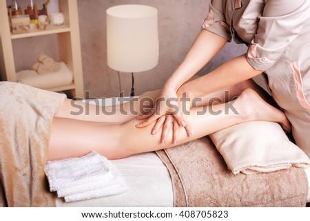 Woman having revitalizing, therapeutic  foot massage in Spa Salon - stock photo