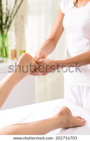 Woman having spa feet treatment - stock photo