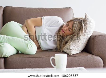 Woman having stomach pain - stock photo