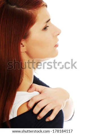 Woman heaving back ache, isolated on white background - stock photo