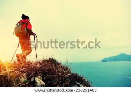 woman hiker hiking on seaside trail  - stock photo