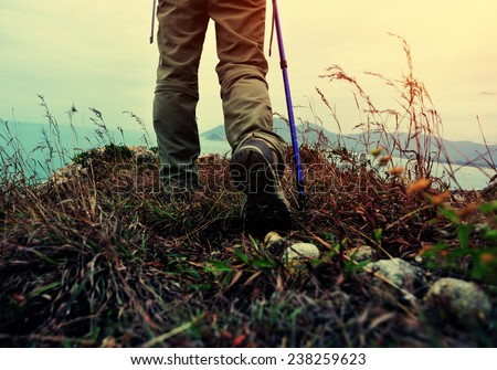 woman hiker hiking on seaside trail  - stock photo