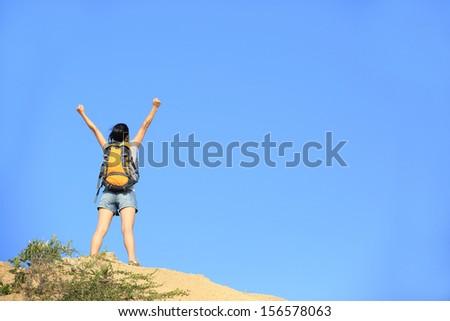 woman hiker open arms mountain peak  - stock photo