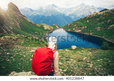 Woman Hiker with red backpack mountaineering Travel Lifestyle concept lake and mountains landscape on background journey vacations outdoor  - stock photo
