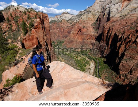 Woman hiking Angels Landing in Zion National Park - stock photo