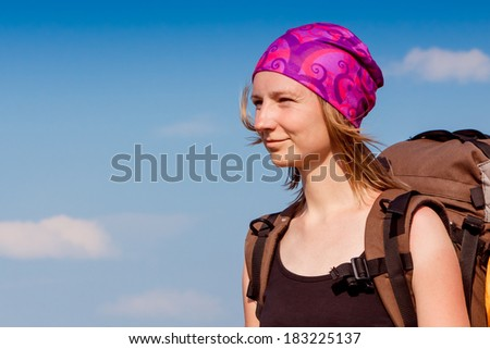 Woman hiking portrait with copy space. Fresh and healthy female model during hike - stock photo
