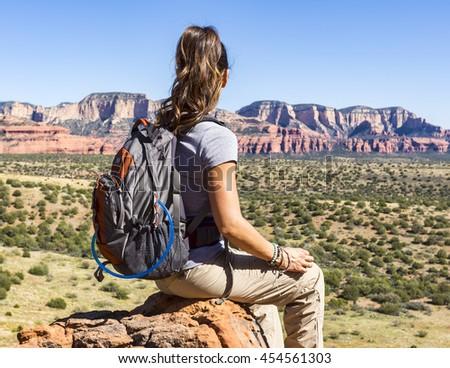 Woman hiking takes a break - stock photo