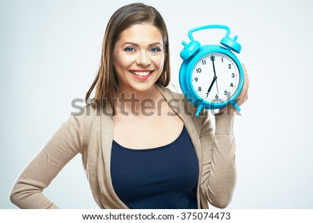 Woman hold alarm clock. White background isolated. Female portrait. - stock photo