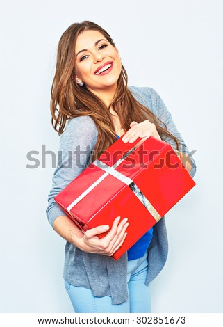 Woman hold gift box. Big smile with teeth. Emotion of happy woman. White wall background. Red gift box.  - stock photo