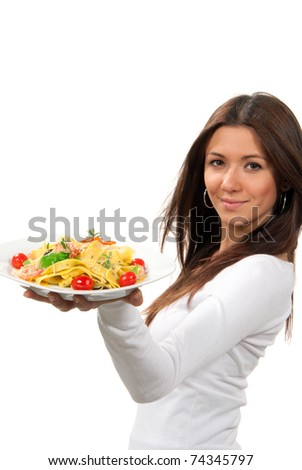 Woman hold plate of diet Italian Shrimp spaghetti vongole pasta with bell pepper, origan, basil and creamy Alfredo sauce and tasting one tomato isolated on a white background - stock photo