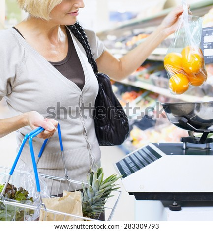 woman hold the shopping trolley - stock photo
