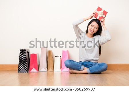 Woman hold up with present box with shopping bag - stock photo