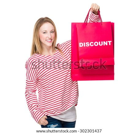 Woman hold with shopping bag and showing discount - stock photo