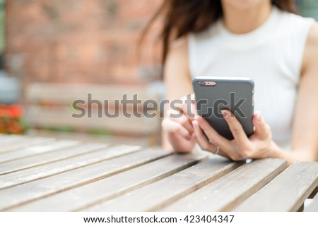 Woman hold with smart phone at coffee shop - stock photo