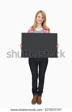 Woman holding a black board against a white background - stock photo