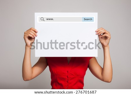 Woman holding a blank paper sheet with an internet search bar on it - stock photo