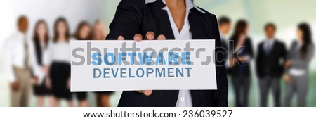 Woman holding a card for her web design firm - stock photo