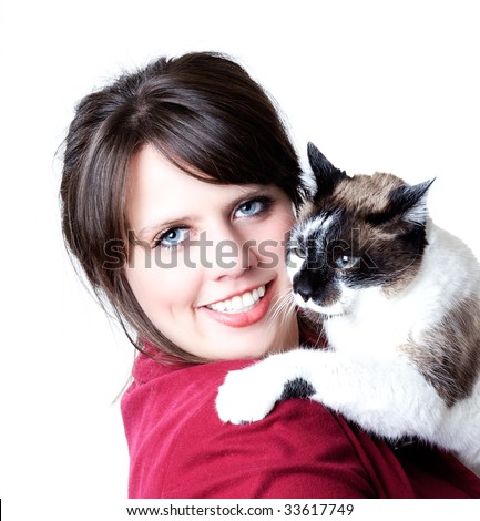 Woman holding a cat in her arms, close-up, isolated on a white background; high contrast. - stock photo