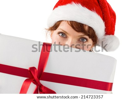 Woman holding a christmas present on white background - stock photo